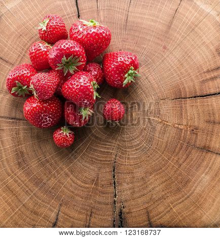 Strawberries on the old wooden board.