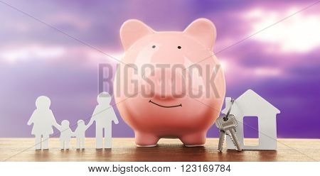 Pig money box and paper decor on a table, sunset background