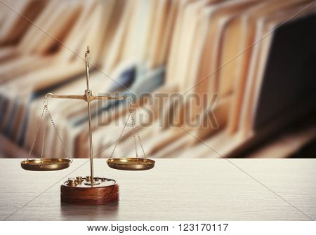 Scales on table in library. Law concept