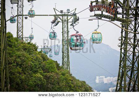 HONG KONG HONG KONG - OCTOBER 01: cable cars over tropical trees in Hong Kong on October 01 2012