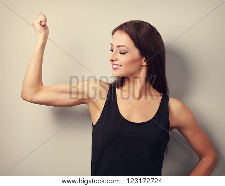 Strong Fitness Young Woman Showing Muscle Bicep With Happy Smiling. Toned Portrait