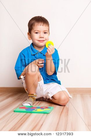 Boy Plaing With Toy