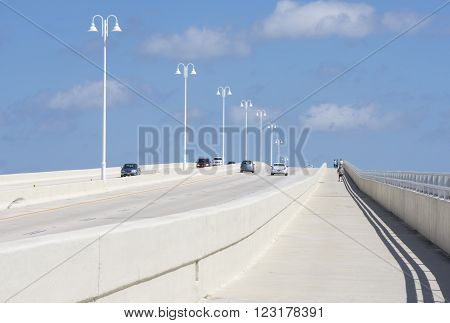 ST. PETERSBURG FLORIDA USA - FEBRUARY 25 2016: Two-way traffic and a pedestrian walkway on the highway 682 concrete bridge connect St. Pete Beach and Isla del Sol on Florida's gulf coast.