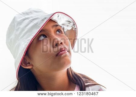Cute little girl with hat studio portrait. Isolated over white background.