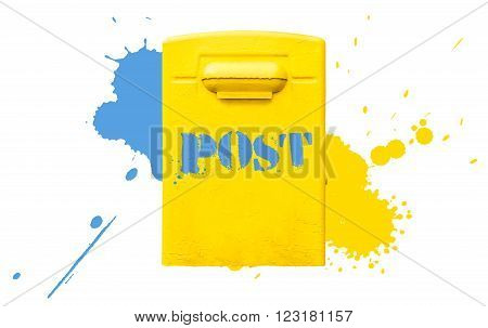Yellow post office mailbox on plastered wall with paint splashes in blue and yellow colors