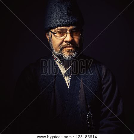Portrait of a middle aged man wearing an old fashioned clothes from Serbia.