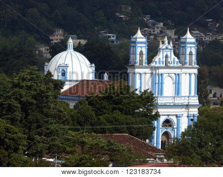 The blue colonial Santa Lucia church as seen from a hill in San Cristobal de las Casas Chiapas Mexico.
