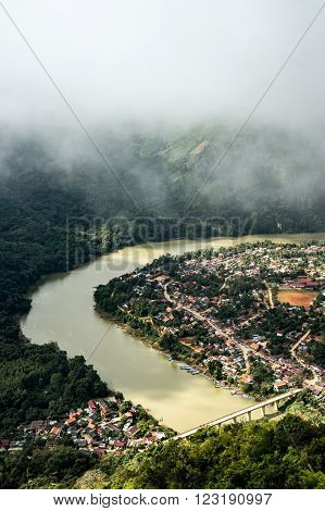 Aerial view of Nong Khiaw town in mostly cloudy day