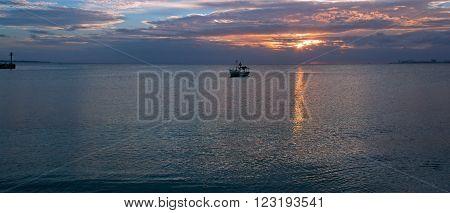 Fishing boat in Puerto Juarez Cancun Mexico at sunrise
