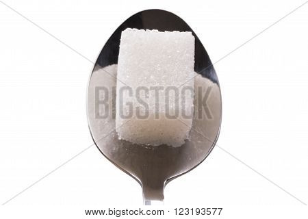 Salt or sugar on a teaspoon isolated on white background