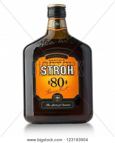 CHISINAU MOLDOVA february 25 2016: Stroh rum bottle on white. Stroh is a distilled from a secret blend of herbs and fruit to hefty strength of 80% alcohol. happy.Sebastian Stroh Austria.