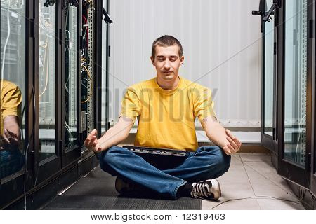 The engineer sits in datacenter