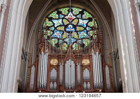 RADOM, POLAND - JULY 4, 2009: Holy Virgin Mary Cathedral's dominant rosette with stained glass above the organ