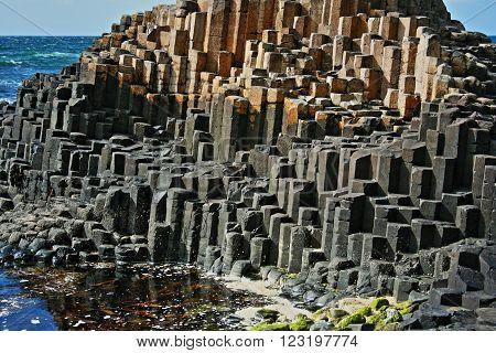 Giants Causeway Basalt Hexagonal Columns leading down to the sea on the Northern Irish Coast