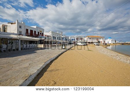 MYKONOS, GREECE - MARCH 06, 2016: Beach and promenade in the old harbor of the Mykonos town on March 06, 2016.