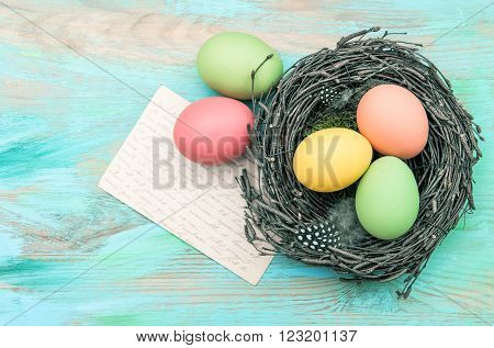 Easter eggs and old greetings card. Nostalgic vintage style toned picture