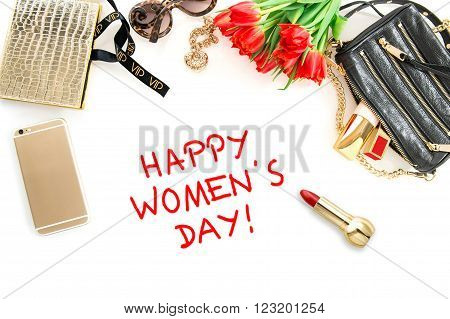 Happy Womens Day! Fashion mock up with accessories flowers cosmetics bag and jewelry.