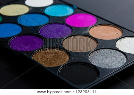 Professional pallet of eyeshadow. Multicoloured crumbled eye shadows.