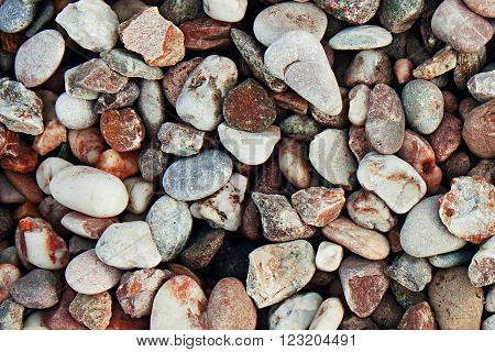 Background of round pebbles. Texture building shingle.