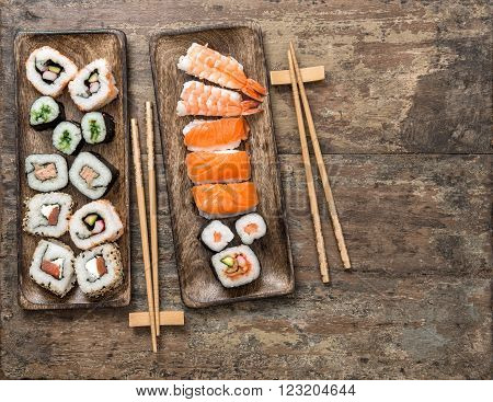 Traditional japanese food. Sushi rolls maki nigiri on rustic wooden background. Seafood