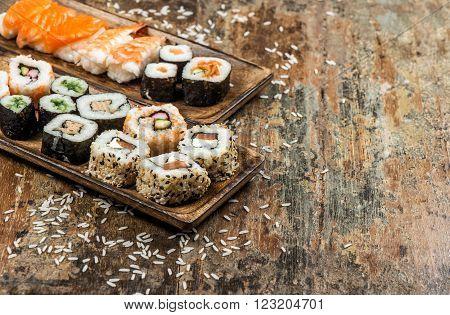 Traditional japanese food. Sushi rolls maki nigiri salmon shrimp tuna tofu rice avocado