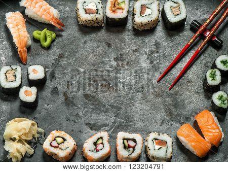 Traditional japanese food. Sushi rolls nigiri salmon wasabi shrimp tuna ginger tofu rice avocado pickled ginger. Asian food frame