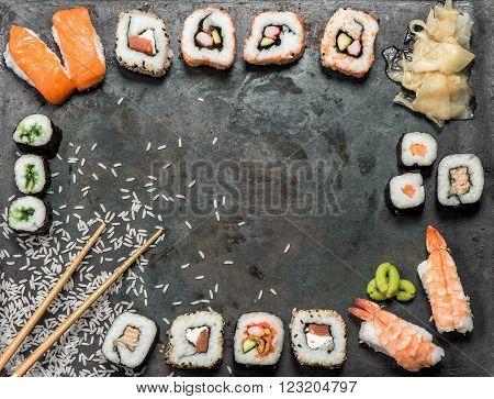 Traditional japanese food. Asian food background. Sushi rolls maki nigiri salmon wasabi shrimp tuna ginger tofu rice avocado pickled ginger