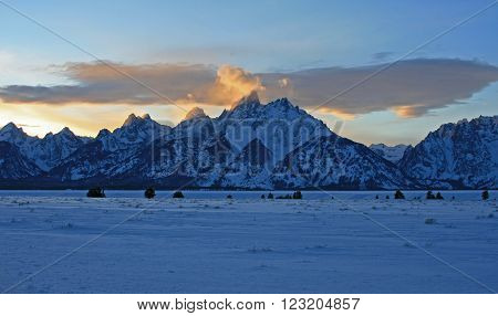 Lenticular cloud over Grand Tetons at sunset in Grand Tetons National Park in Wyoming USA