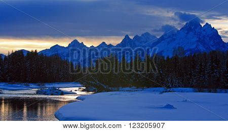 Snake River at sunset below Grand Teton Mountain Range in Wyoming USA