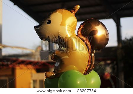 Photograph of an helium squirrel balloon and blurred background