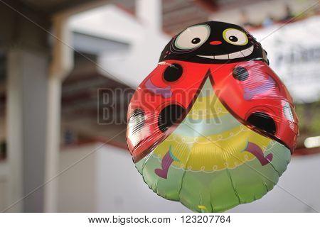 Photograph of an helium colorful ladybug balloon