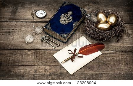Golden easter eggs and antique bible book. Vintage still life