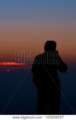 The silhouette photo, Cameraman at the sunset