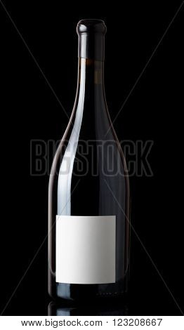 Shiraz red wine in Burgundy style bottle, isolated on black