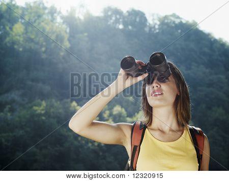 Young Woman Hiking With Binoculars