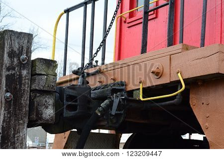 A wooden train coupling that connects the trains together.