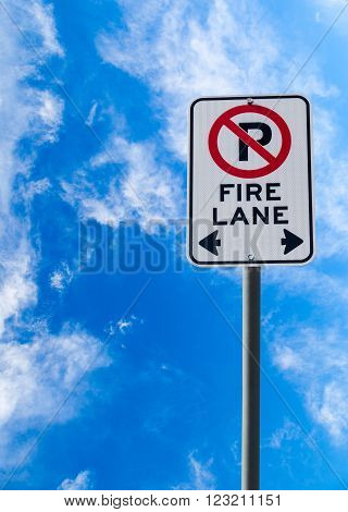 Fire Lane No Parking Sign Against Blue Sky