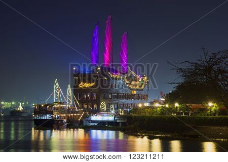 HO CHI MINH CITY, VIETNAM - DECEMBER 20, 2015: Two sightseeing ship at the river port of Ho Chi Minh city. The landmark of Ho Chi Minh city