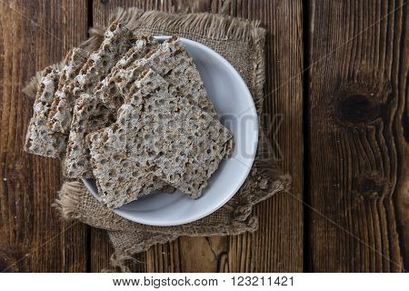 Portion of Crispbread (selective focus) on an old wooden table