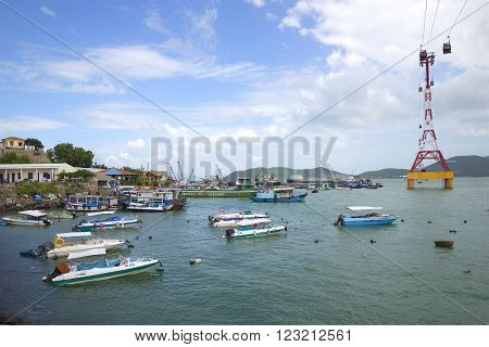 NHA TRANG, VIETNAM - JANUARY 01, 2016: View seaport of Nha Trang city. Tourist and excursion boats are mooring in the sea port of Nha Trang