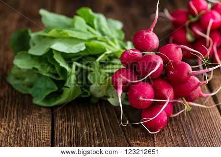 Fresh Radishes (detailed close-up shot; selective focus) on wooden background