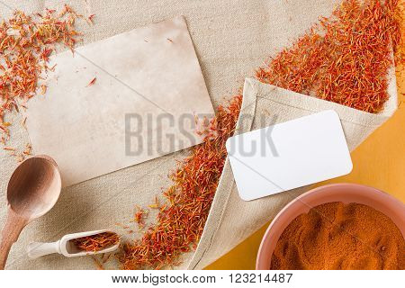 Dried saffron spice on a linen napkin and ground saffron