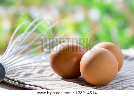 Fresh eggs in the kitchen with a whisk