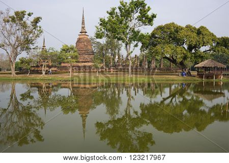 SUKHOTHAI, THAILAND - JANUARY 10, 2014: Ruins of an ancient Buddhist temple in The historic landmark of the city of historical Park. The historic landmark of the city of The historic landmark of the Thailand