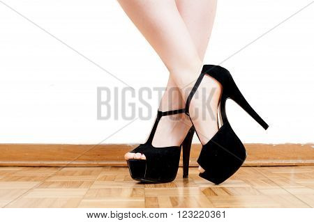 Young woman feet with black high heels and legs
