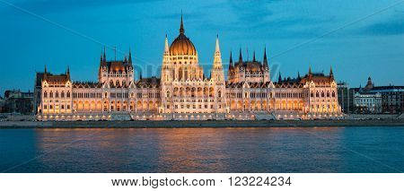 View on parliament building from Buda part of Budapest. Danube river in foreground evening cloudy sky in background. Hungary Europe travel.