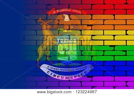 A well worn wall painted with a LGBT rainbow with the Michigan state flag