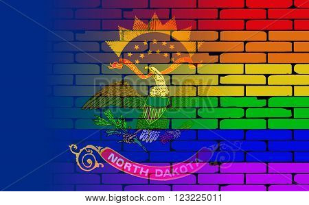 A well worn wall painted with a LGBT rainbow with the North Dakota state flag