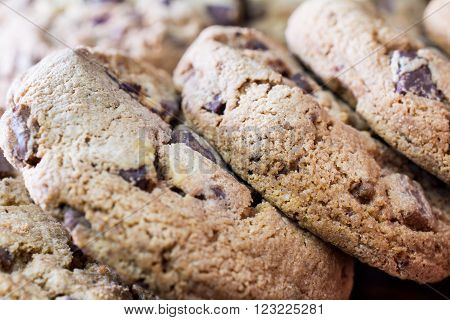 Close Up Of A Lying Pile Of Baked Cookies With Triple Chocolate, In Front Of Other Biscuits