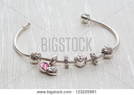 Women's Bracelet charms close-up, jewelry, luxury, decoration